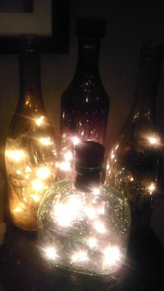 Christmas lights in bottles I made! Boyfriend had to drill the holes for me!