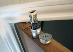 Cigar tube in the top of a door.  Small hiding place.