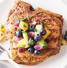 The grill rub and the salsa mingle to create a flavor explosion! Pork Chops with Blueberry-Mango Salsa is a quick and delicious main dish.