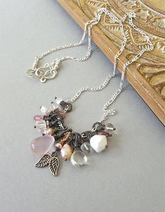 The Angelskin necklace:  mixed gemstone and freshwater pearl charms - all carefully wirewrapped, oxidised and placed on bright sterling chain.