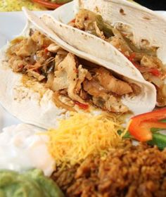 Reynolds® Chicken Fajitas - This scrumptious Chicken Fajita slow cooker recipe from the Reynolds® Kitchen is the perfect recipe when you're cookin' for a crowd or party.