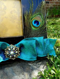 peacock feather and ribbon picture frame