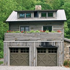 A rustic home calls for garage doors that fit the part. Decorative cross buck panels on the carriage style garage doors echo the look of barn doors. The deep paint color suits the structure's gray palette and picks up the imperfections and lowlights in the weathered siding and stonework. Garage doors: Clopay Reserve Collection in cedar painted Sherwin-Williams Urbane Bronze (SW7048) www.clopay.com | via Southern Living.