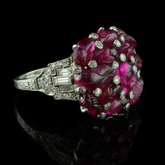 ART DECO.c1930.Carved ruby and diamond cluster ring