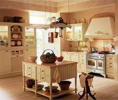 A kitchen like this with more windows. BIG windows, and a door leading to the porch would be perfect.