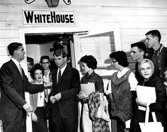 """Robert Kennedy, brother of presidential candidate John, hoped it was a good omen when he was escorted into the """"White House"""" at the University of Omaha by faculty member Roger Dunbier. The """"White House,"""" a physical education classroom, was named for its color. Kennedy visited Omaha in September 1960. THE WORLD-HERALD  Like anything you see? Contact Michelle at michelle.gullett@owh.com or call 402-444-1014 to purchase prints."""