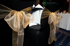 Black stretch chair covers with gold sash - £2.45 each including fitting