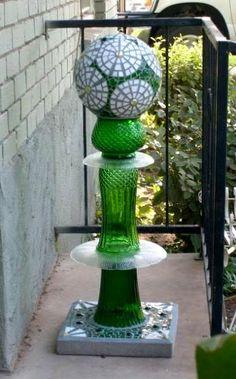 garden junk, bowling ball art, bowl ball, ball totem, yard art, plate, glass, mosaic, totem poles