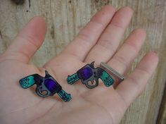 sweet little purple and teal tattoo pistol ear studs/posts from etsy.com | $16.00