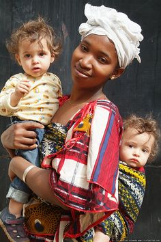 a woman in Senegal with two children