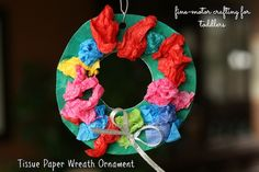 Tissue paper wreath ornaments - a great fine motor craft for toddlers. (happy hooligans)