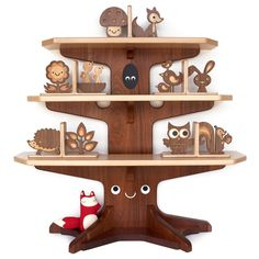 Happy tree bookshelf with animal bookends.