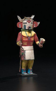 Hopi Rugan B Rasp Katsina with ears of corn painted under eyes; katsina holds a rasp, height 10.25 in. ca 1930