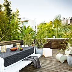 """Expanded cottage: Rooftop deck When you can't expand out, go vertical. """"We've got a backyard—it's just on the roof,"""" says Mark. """"It feels like a treehouse up there above it all."""""""