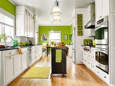 long, open, galley kitchen with island in this Busted Open, Brightened Up kitchen remodel from this old house