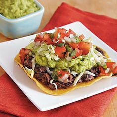 Veggie Tostadas with Black Beans and Easy Guacamole ....   Looks great!