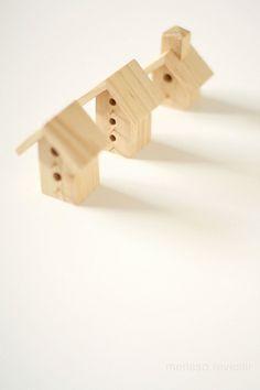 Three wooden tiny houses