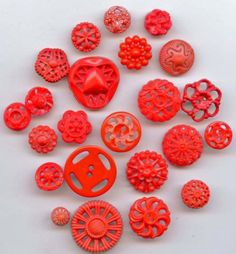 SOLD: red color pierced plastic buttons vintage buttons