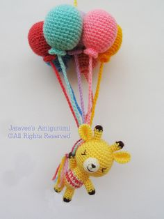 Giraffe and balloons by Jaravee, via Flickr