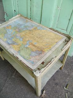 upcycled vintage coffee table w/1930s Europe map - $89 on Etsy. *I need this!!*