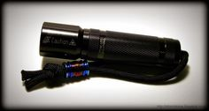 Flashlight with paracord two-strand footrope knot and flame anodized titanium bead.
