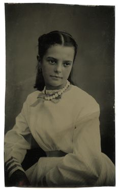 1860s, young girl style (back buttoning) . . . beautiful striped cotton. Beaded necklace.