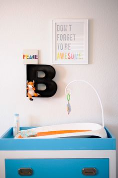 Modern Gallery Wall and Changing Table in Bahama Blue