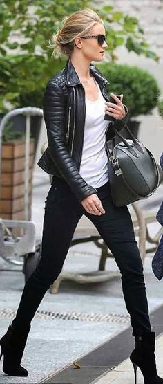 Stunning black leather jacket over casual white tee, leggings and boots.