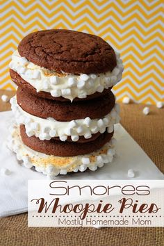 Smores Whoopie Pies - Classic whoopie pies get a smores twist with chocolate fudge cake mix, marshallow buttercream frosting, graham cracker crumbs, and marshmallow bits!