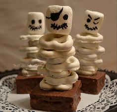 Halloween skeleton brownies - use little debbie devils cakes, push a pretzel in and stack white chocolate covered pretzels down pretzel. Top with marshmallow & use black cake coloring on the tip of a toothpick to make faces