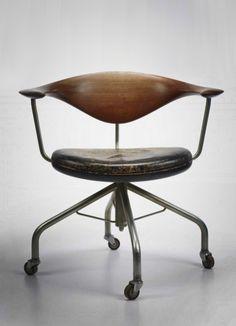 HANS WEGNER Swivel desk chair by Johannes Hansen Denmark, 1955, teak, leather, chrome-plated steel