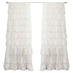 "Ivory curtain panel with handmade ruffles.   Product: Set of 2 curtain panelsConstruction Material: 100% PolyesterColor: IvoryFeatures: Handmade ruffle detailsDimensions: 84"" H x 50"" W eachCleaning and Care: Machine washable"
