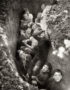 Children in bomb shelter, England, 1940-41. @designerwallace
