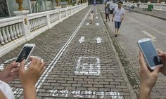 Chinese city opens 'phone lane' for texting pedestrians: City authorities in Chongqing have introduced a 30 metre 'cellphone lane' for pedestrians – is it a step too far in the name of public safety?