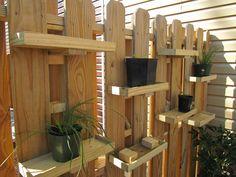 DIY plant shelves for a garden fence