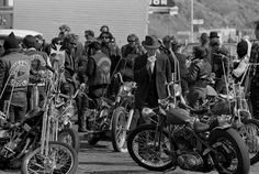 An unlikely Bakersfield citizen casts what appears to be an appraising eye over the Hells Angels' Harley-Davidsons, 1965