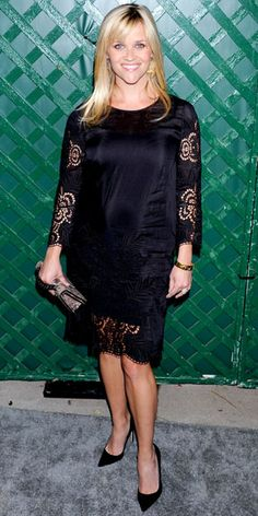 ...in an eyelet Stella McCartney LBD and faux python clutch. Gold jewelry and pointy-toe heels completed the look.