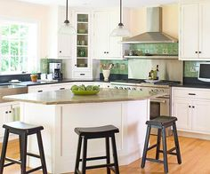 Budget Countertop Ideas - Mix and Match Materials. Reserve expensive countertops for a small island and use laminate or ceramic tile elsewhere. kitchen idea, island shape, kitchen design, corner cabinets, countertop idea, kitchen space, white cabinets, kitchen islands, white kitchens