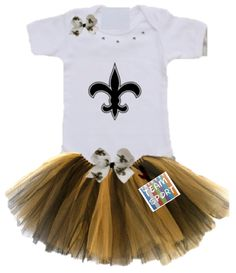 This+set+includes+a+onesie+or+a+t-shirt+with+a+tutu,+and+one+bow.+You+can+choose+to+have+the+bow+for+the+skirt,+the+shirt,+or+a+head+bow.+A+name+and+number+can+be+added+to+this+set. Names+and+Numbers+will+be+a+solid+color+unless+upgraded+to+a+two+trim.+