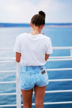 high bun, white oversized tee, high wasted blue jean shorts. casual love