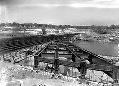 I-235 Des Moines River bridge under construction - 2nd Ave. on-ramp, 1963. View is looking to the east.
