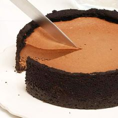 Irish cream liquer adds decadent flavor to this creamy cheesecake. See more St. Patrick's Day desserts: http://www.bhg.com/holidays/st-patricks-day/recipes/delicious-st-patricks-day-desserts/?socsrc=bhgpin030813irishcheesecake=10