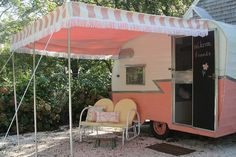 vintage camper with pink and white awning + chalkboard door...love it.