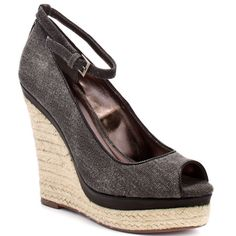 Create a ruckus with these beautiful espadrilles from Charles by Charles David.  Ruckus has a black canvas upper with an adjustable ankle strap.  Completing this spring and summer look is a 1 inch platform and 5 inch wedge. - HighOnShoes.com