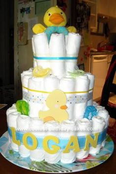 Homemade Rubber Ducky Diaper Cake: This Rubber Ducky Diaper Cake is three tiers.  I used almost 2 packs of Pampers Swaddlers diapers, size 1.  I made it for my cousin's baby shower that's