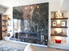 this incredible linear fireplace is highlighted with a dramatic marble wall. marbl wall, fireplac linear, linear fireplac