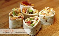 7 layer dip tortilla pinwheels - easy to make and perfect for parties, snacks, or lunch!