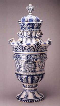 Tulip vase with the arms of Willem III by.   Delft vases come from Holland, and tulips...oh, I see.