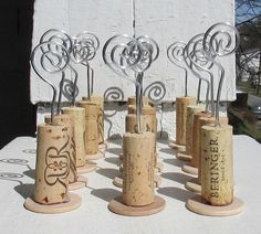 wine cork picture holders- would be cute for table numbers at a wedding