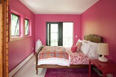 Pink bedroom in a lake home in Berkshire, Massachusetts